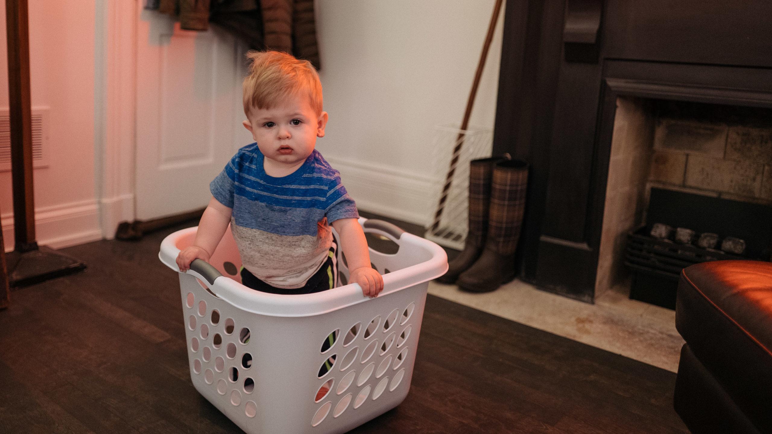 boy in laundry basket