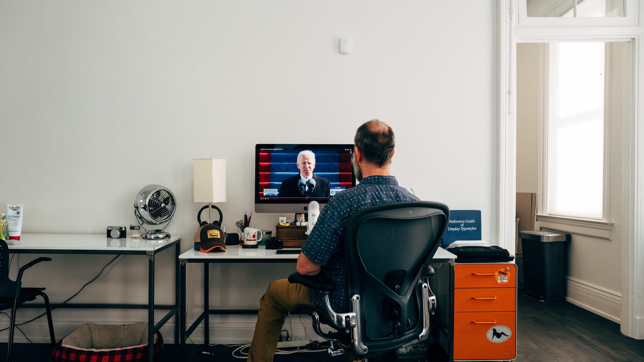 Balding man watching balding man being sworn in as US President