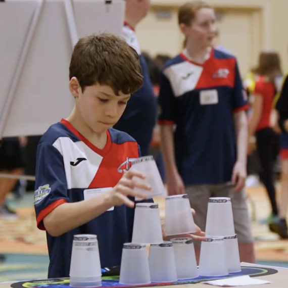 Kid stacking cups