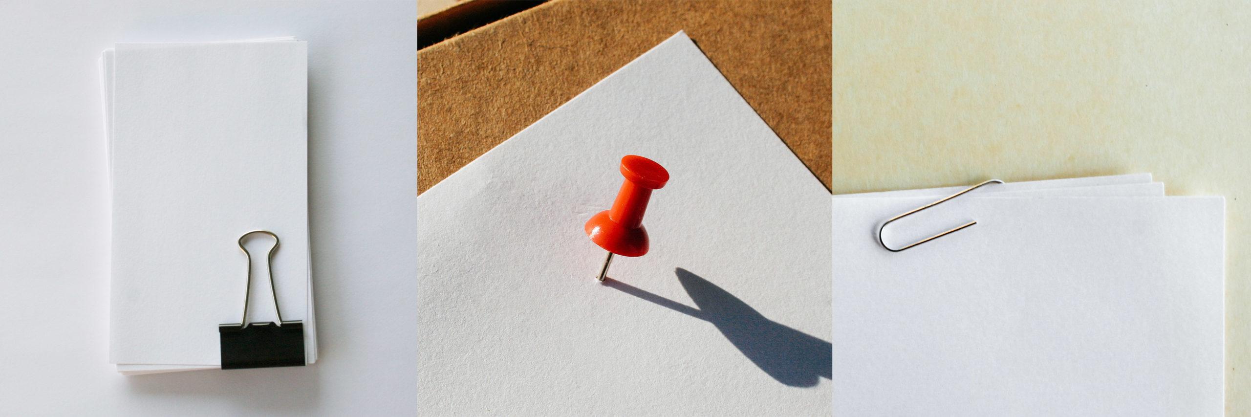 A pushpin, a paperclip, a binder clip