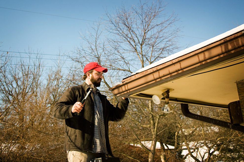 Chris Glass cleans his gutter