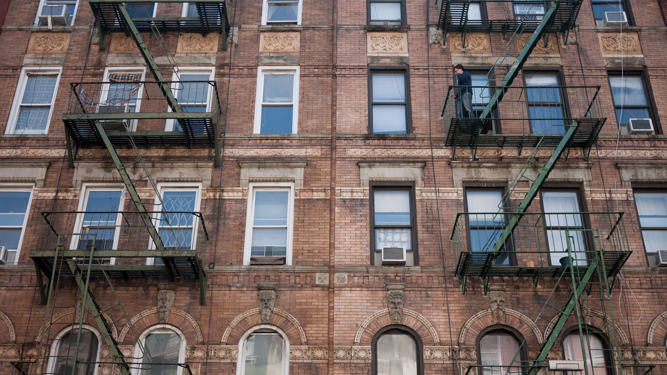 An old brick building with fire escapes in New York City