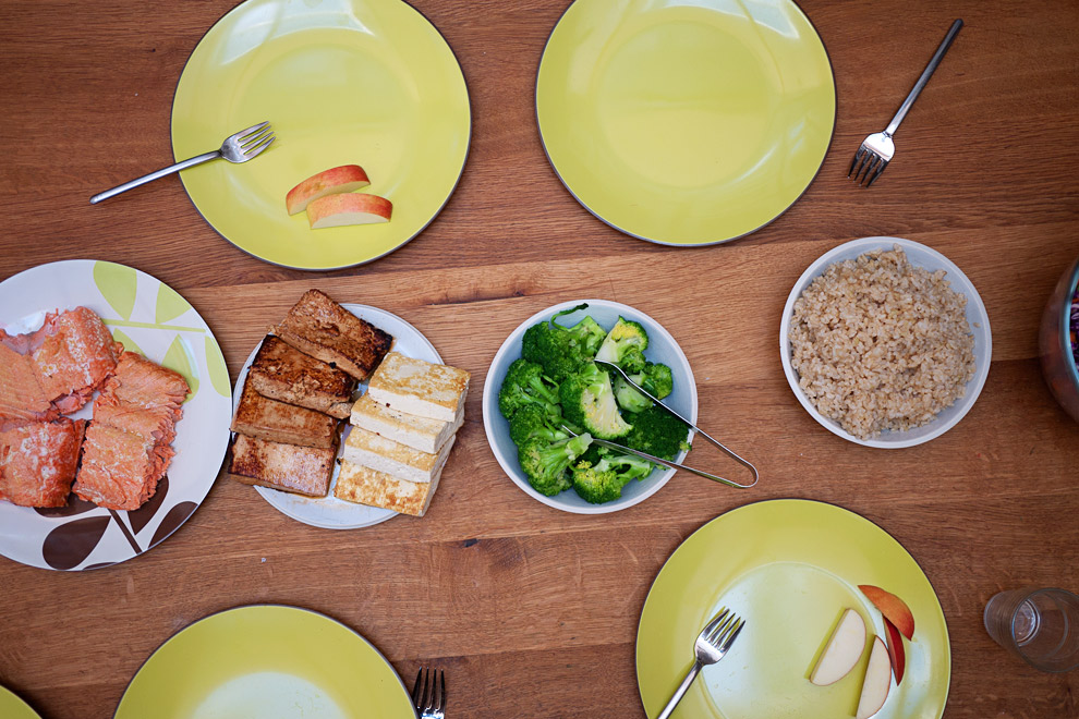 A healthy dinner of salmon, tofu and broccoli