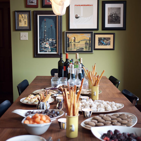 A spread of food and a wall of art