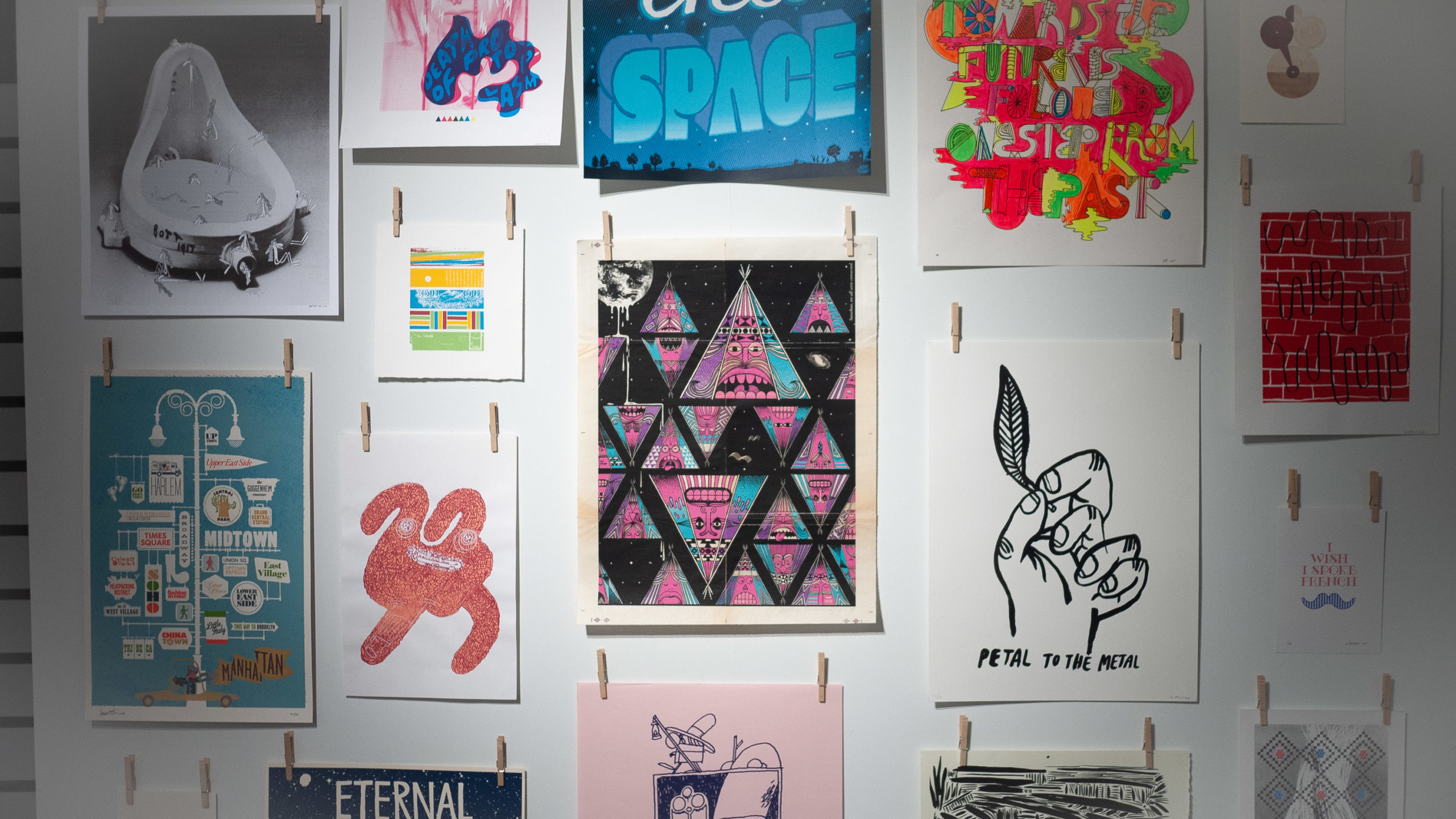 A gallery wall with lots of screenprinted posters