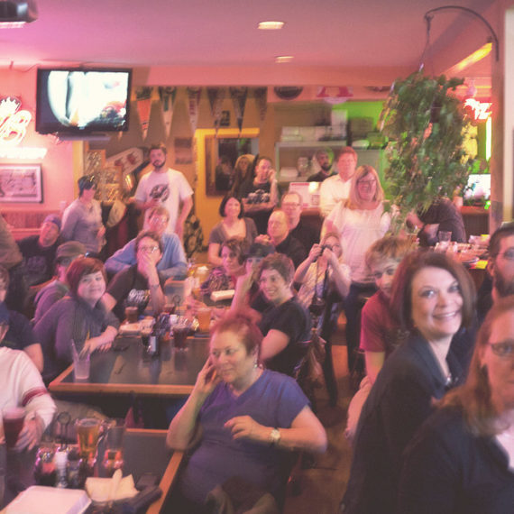 audience of people in a small bar