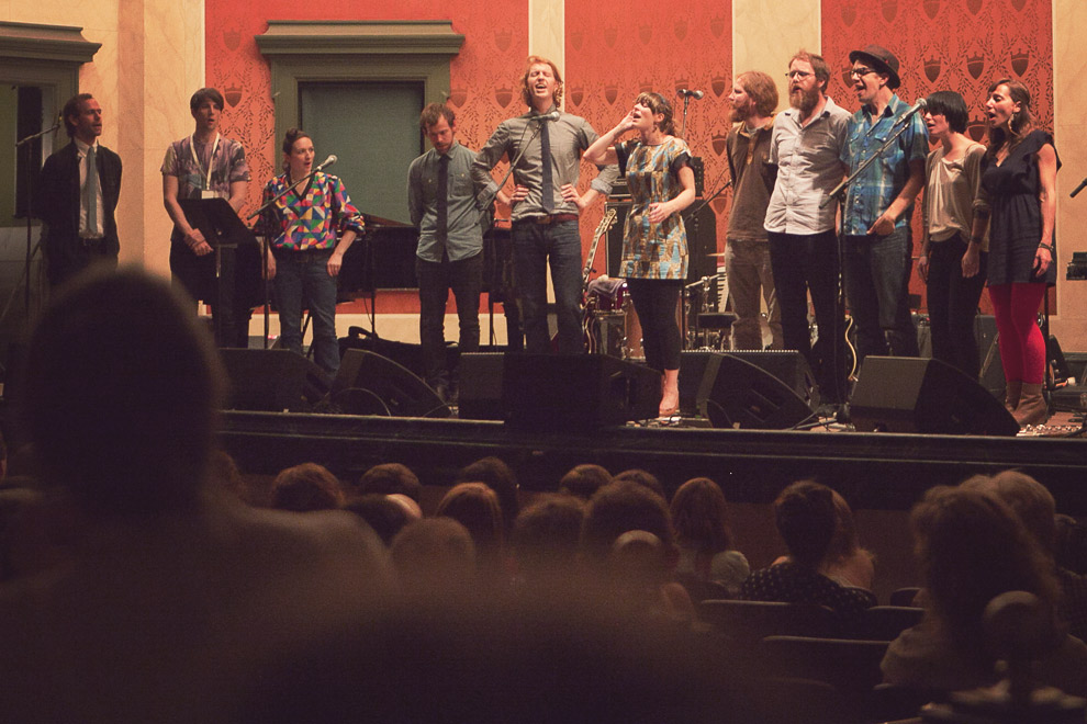A group of musicians on stage signing acapella