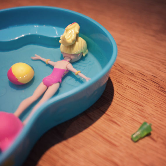 a toy doll face down in a toy pool