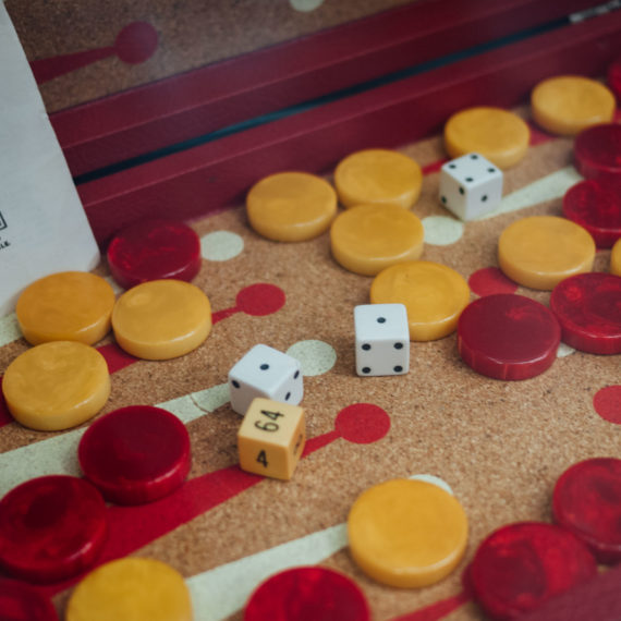 A vintage Backgammon set with red and yellow pieces