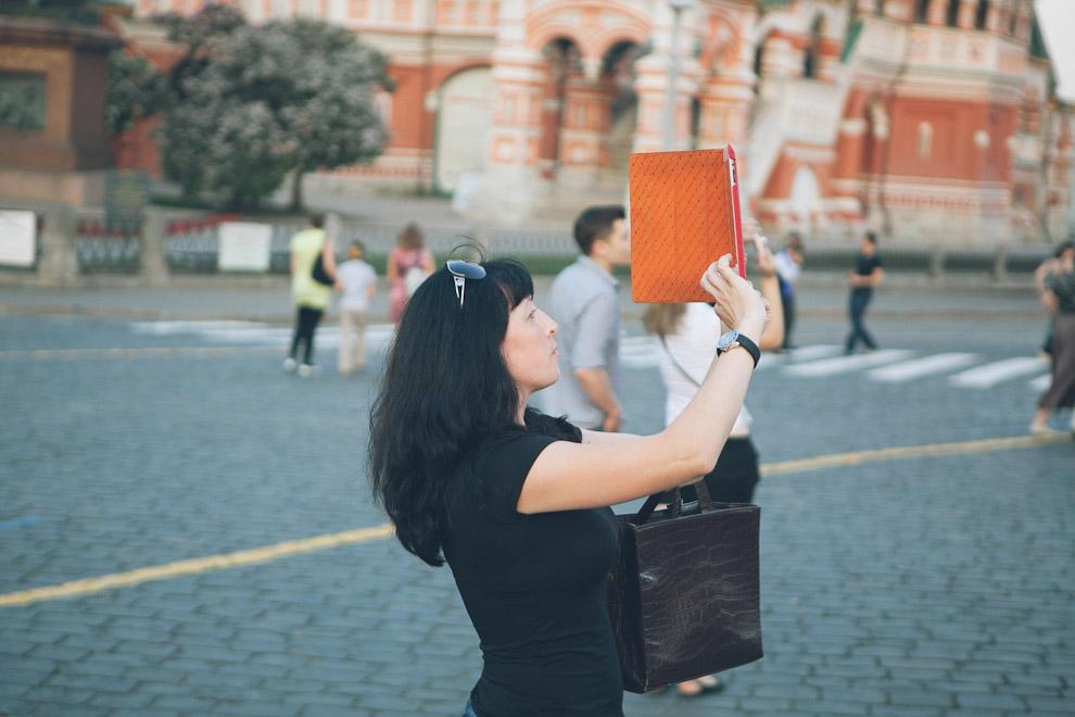 Woman taking photo with iPad