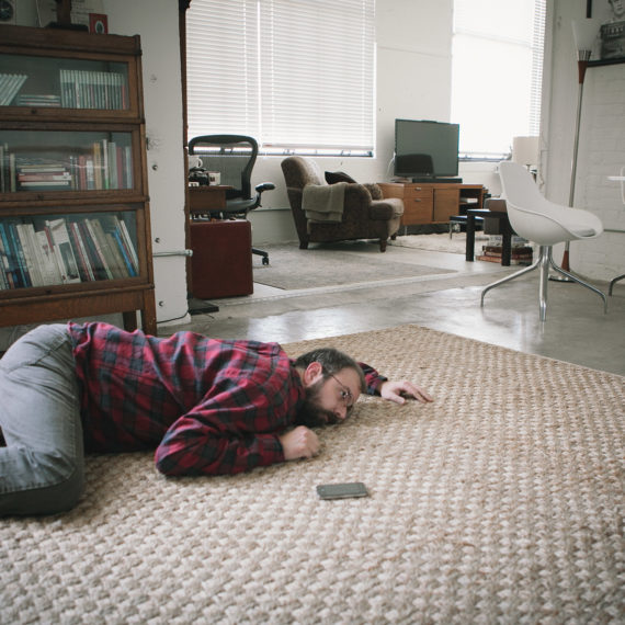 Chris Glass lying on the floor