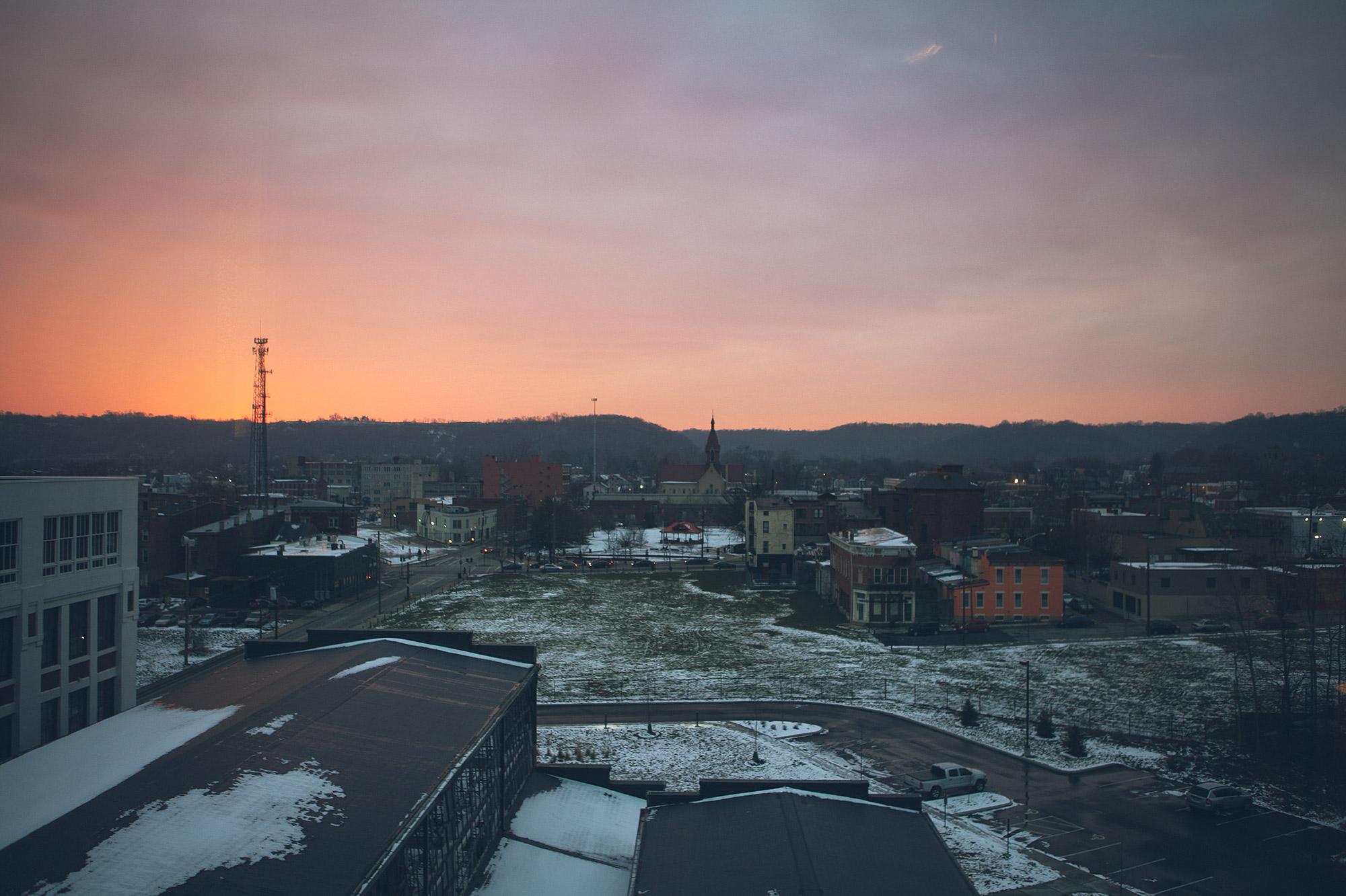 A tiny bit of snow, a neighborhood at sunset