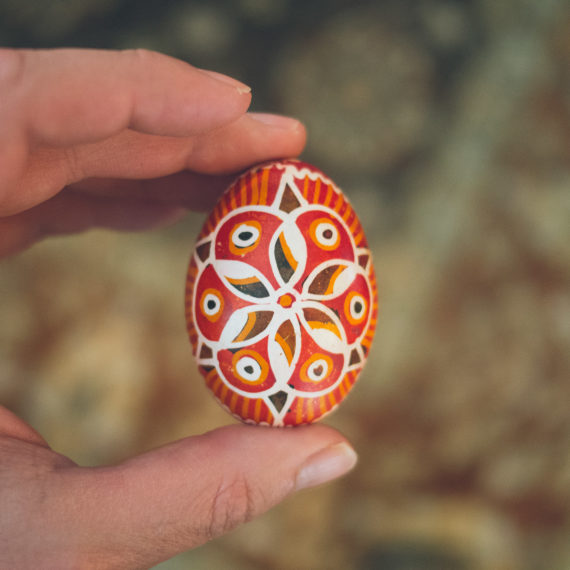 A man holding an Easter egg