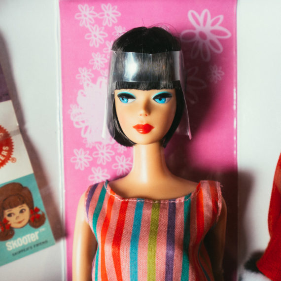 A Barbie doll, partially still in her box