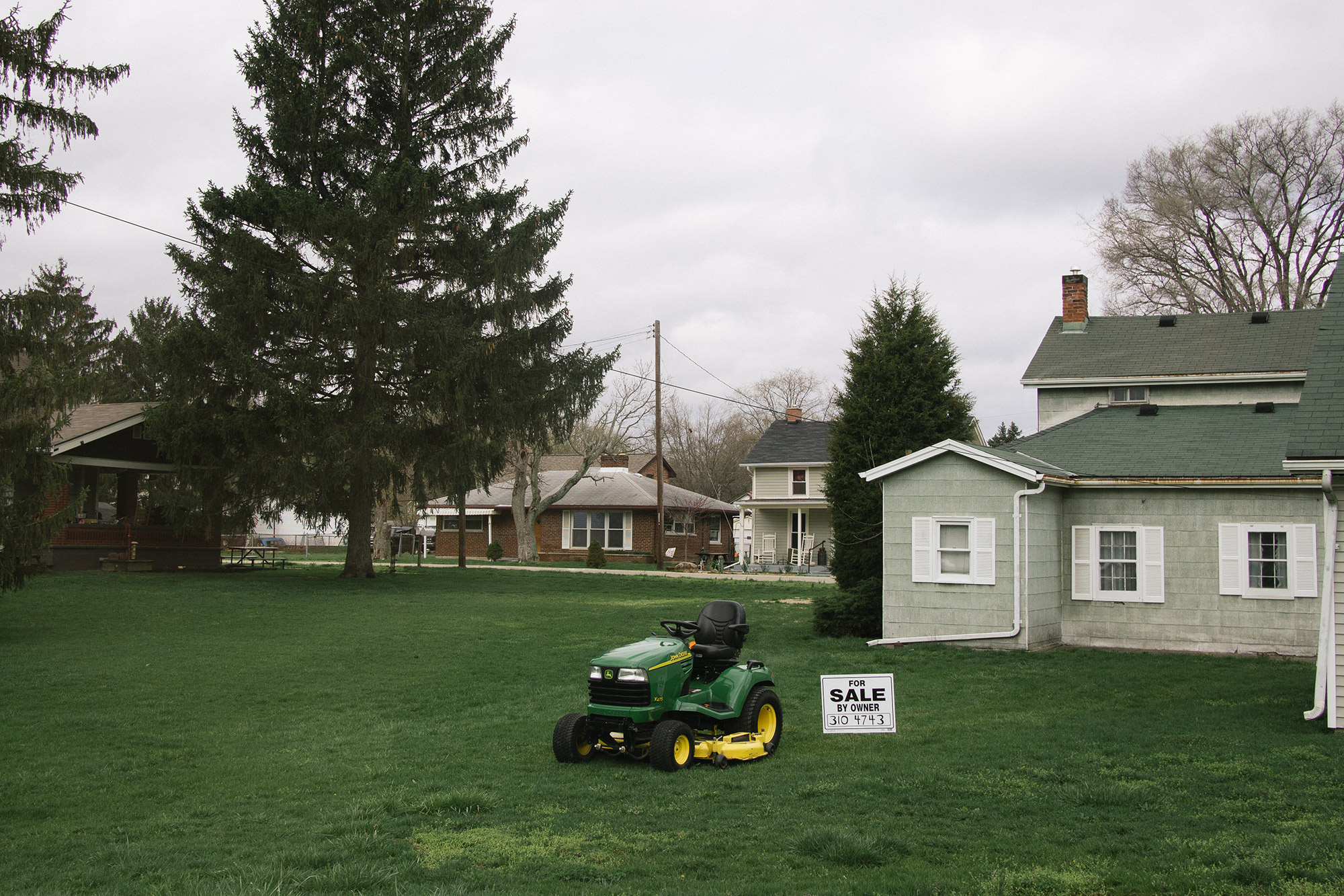 A lawnmower in the middle of grass