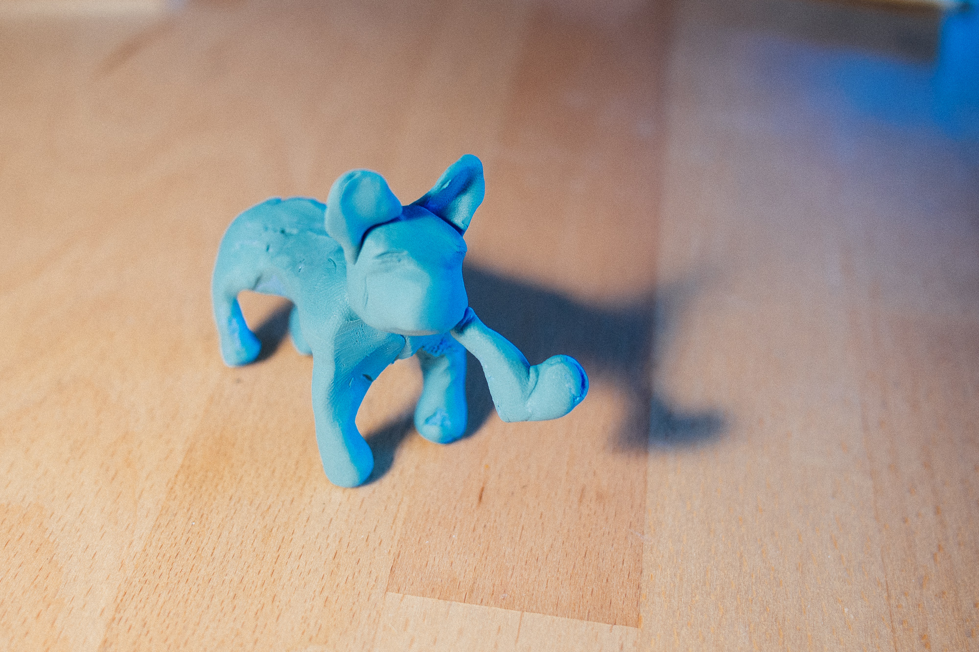 A dog made out of blue clay