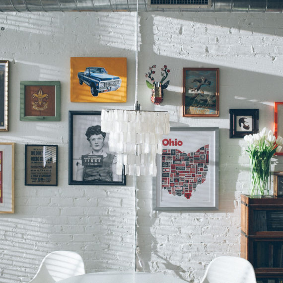 Prints hung on a wall in parlor style