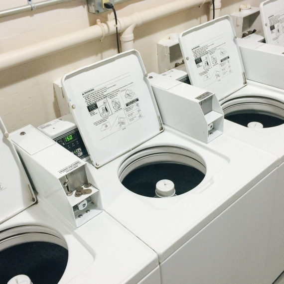 Commercial laundry washers with open lids