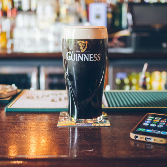 A pint of Guinness on a bar