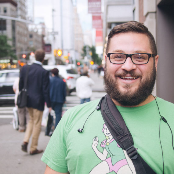 A man smiling in a green t-shirt