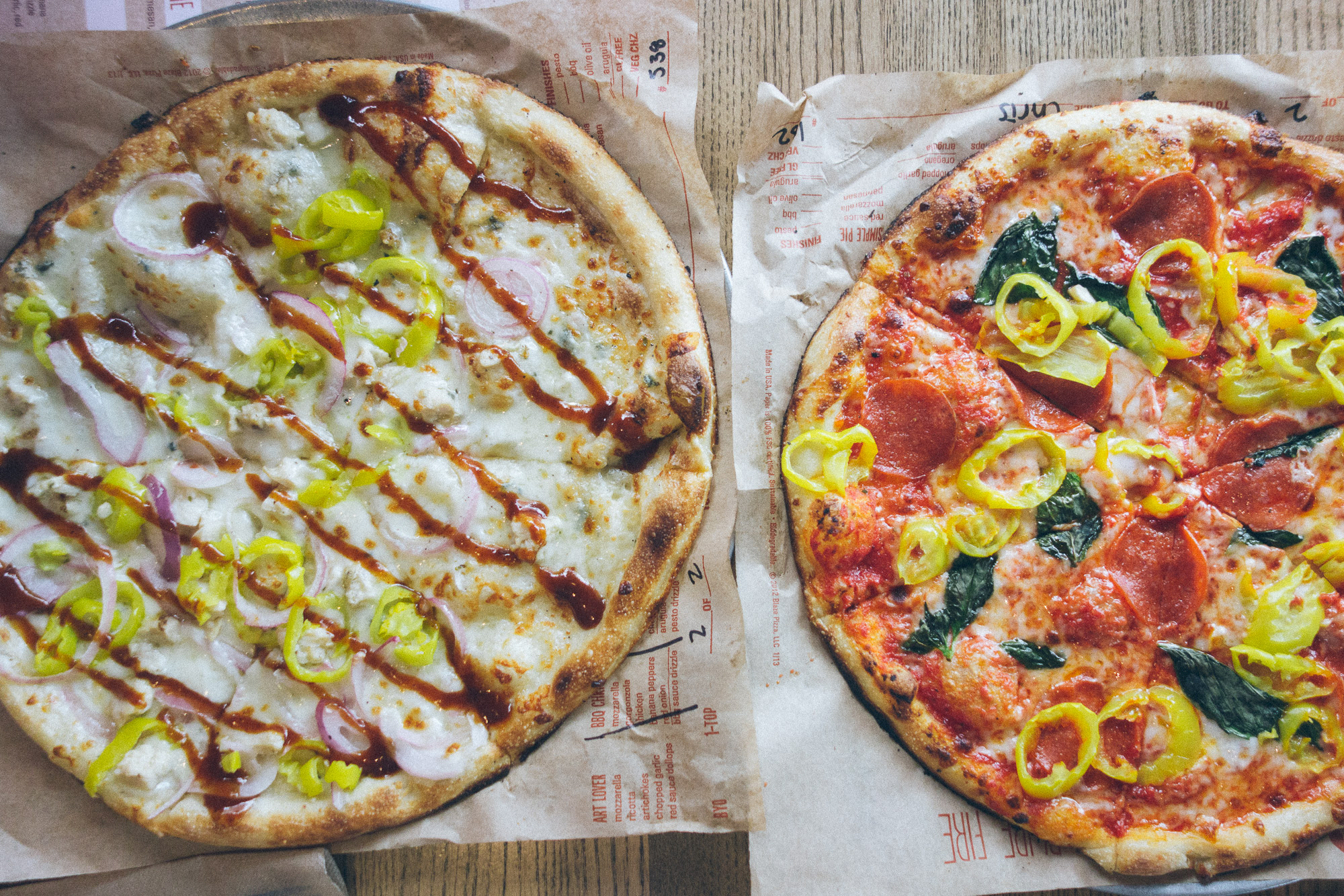 Two pizzas with different toppings