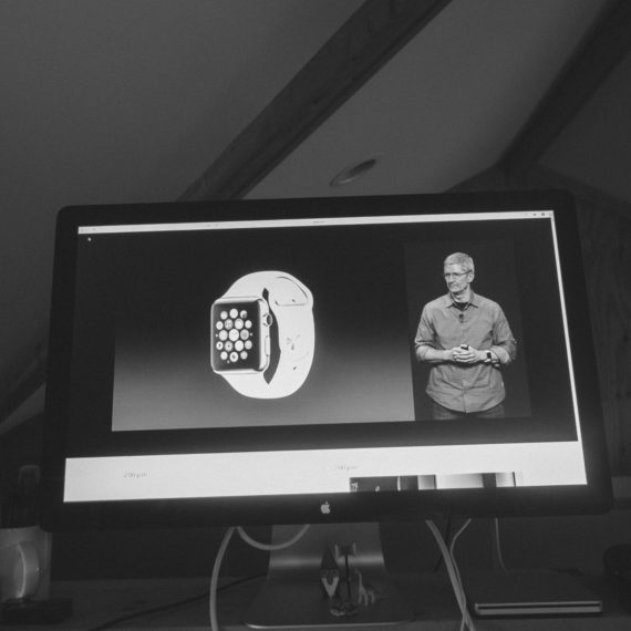 A presentation by Tim Cook announcing the Apple Watch as seen on a computer monitor