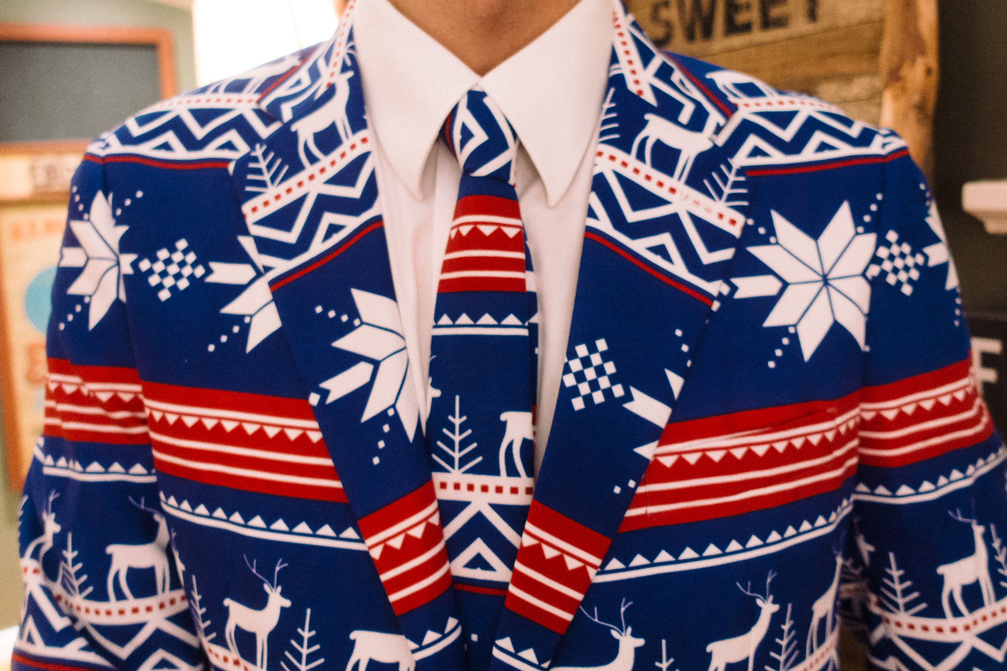 A suit with snowflakes and stripes pattern