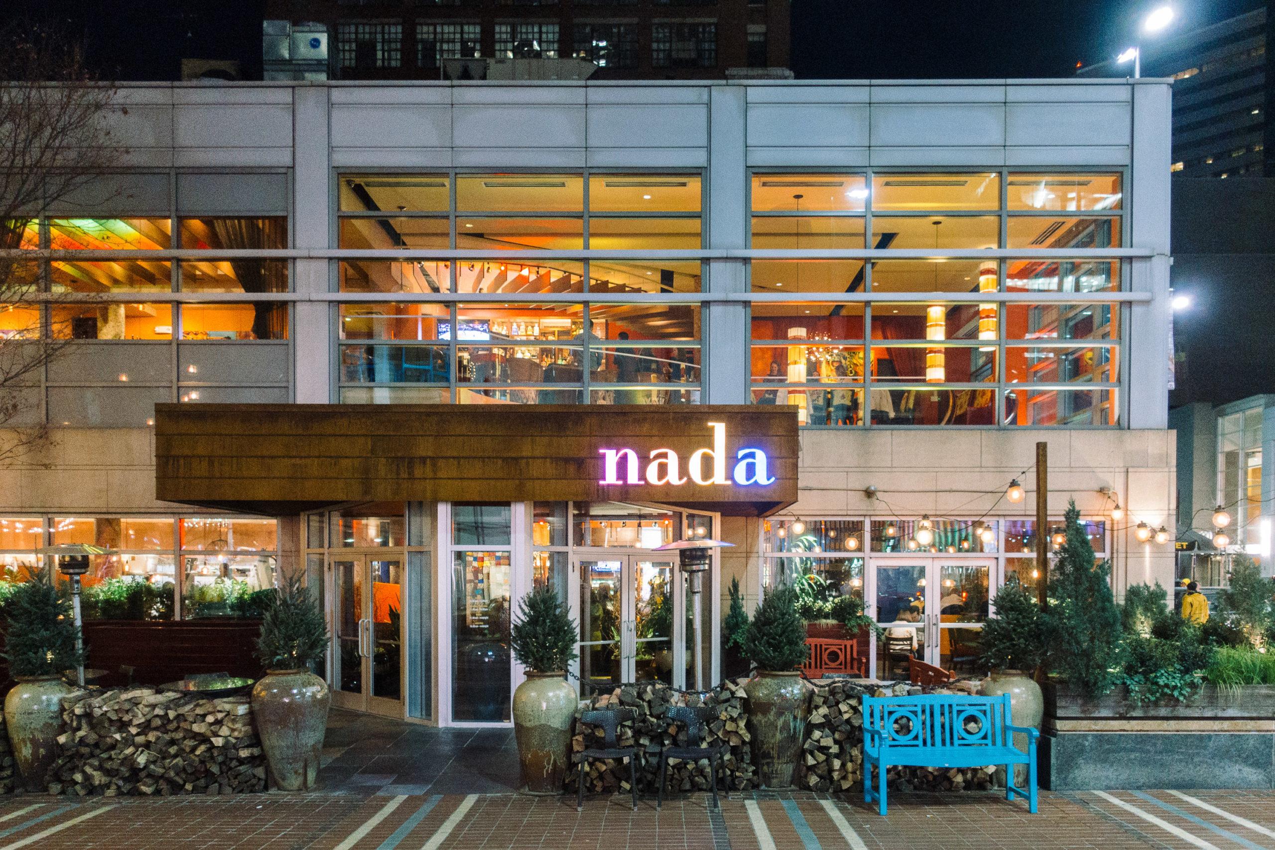 a restaurant exterior at night