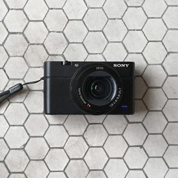 A camera on a floor of hexagon tiles