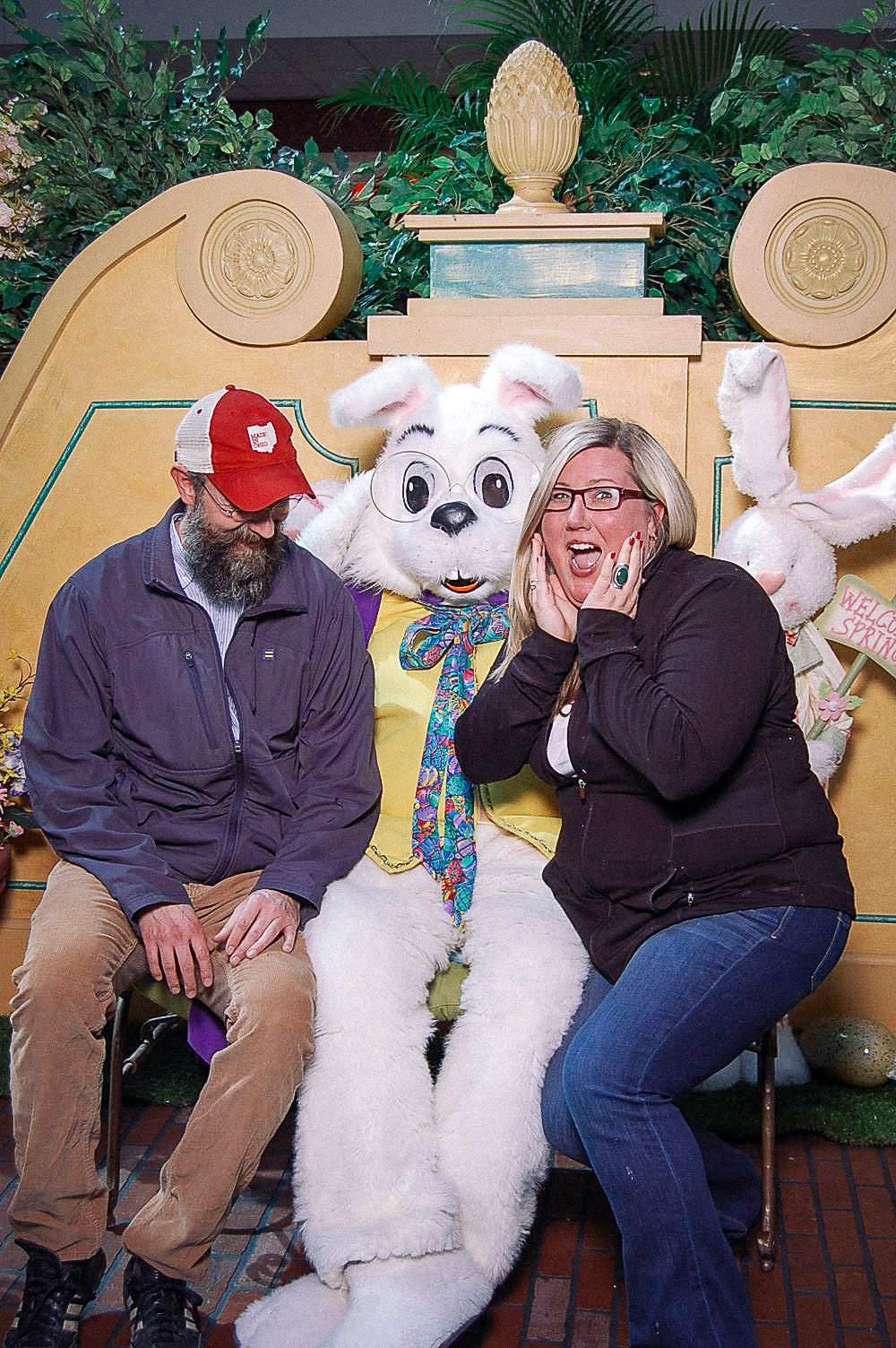 A grown ass man and a grown ass woman on the Easter Bunny's lap