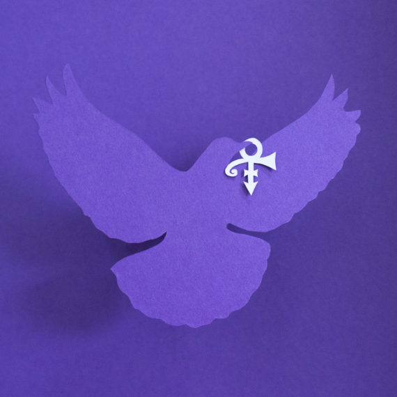 A purple dove and Prince symbol made of cut paper