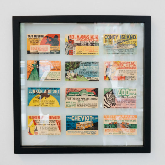 A framed display of 12 historic attraction tickets for Cincinnati