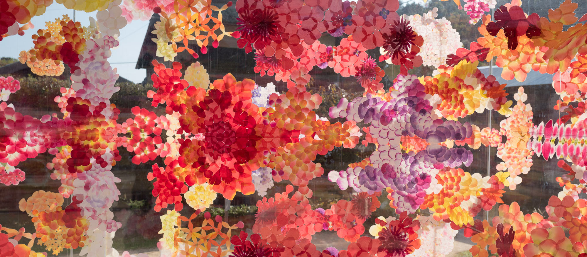 Colorful flower artwork sandwiched between layers of glass