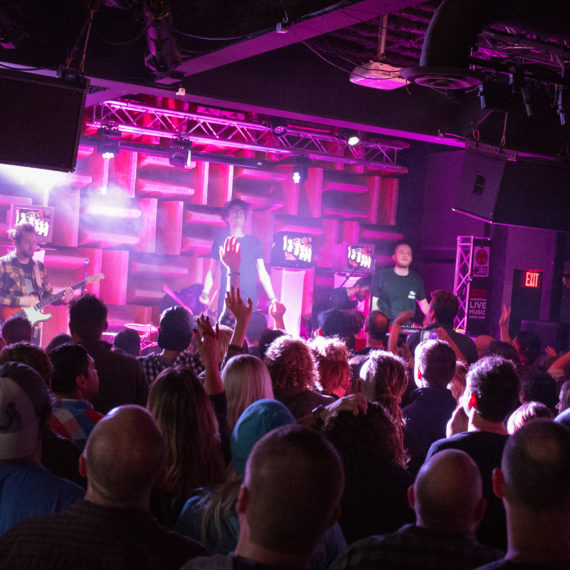 A band performing at a small music venue