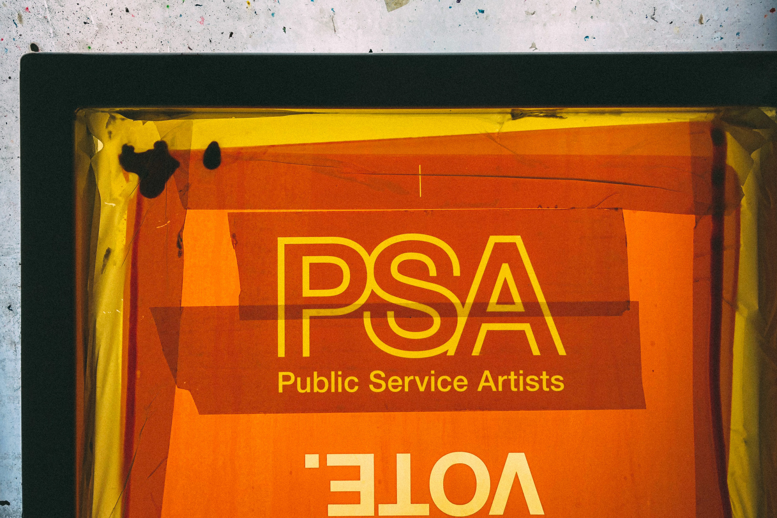 A screen printing screen with the letters PSA