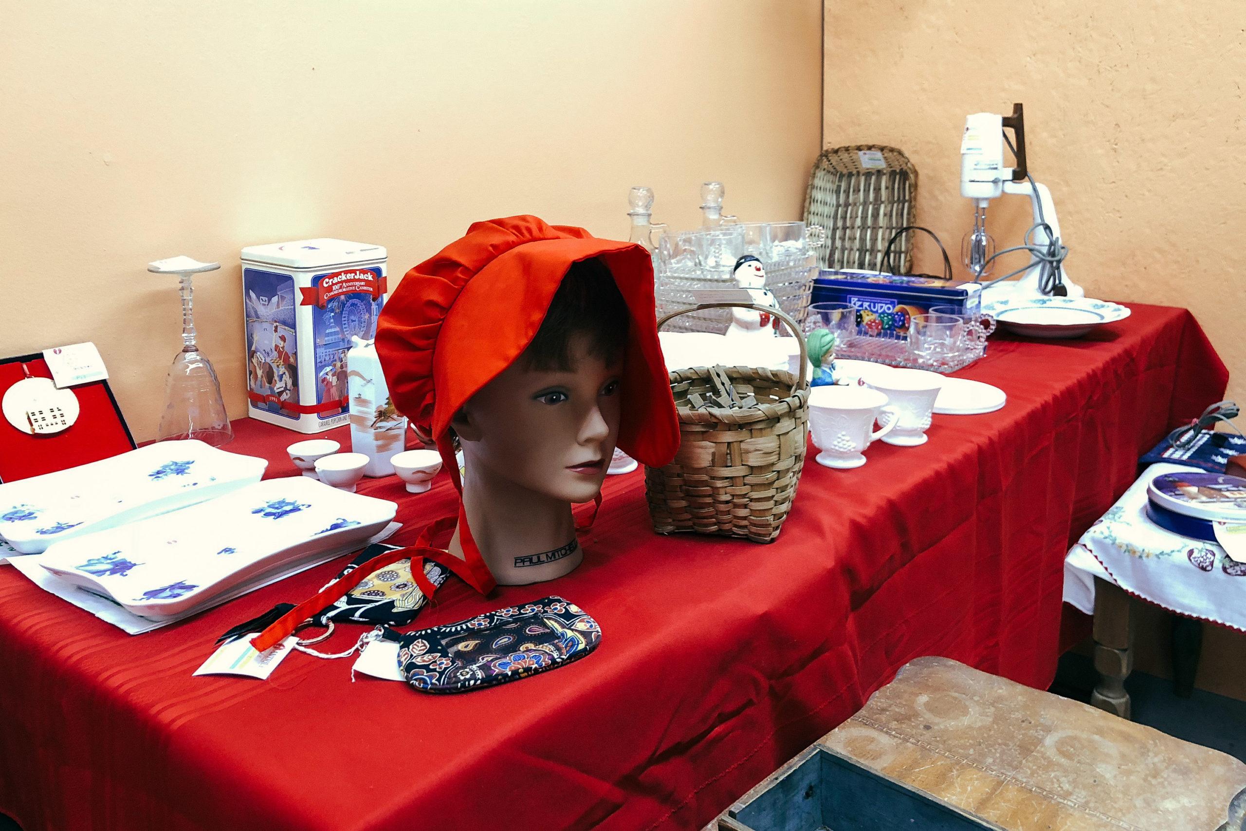 In manikin head with a red bonnet