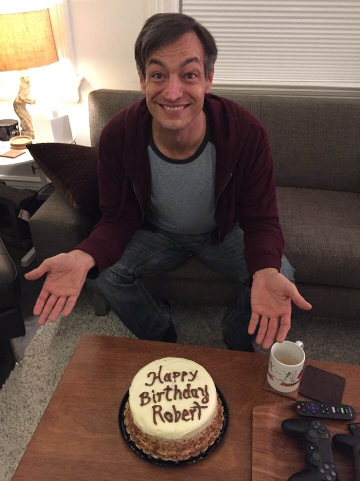 A man with a birthday cake