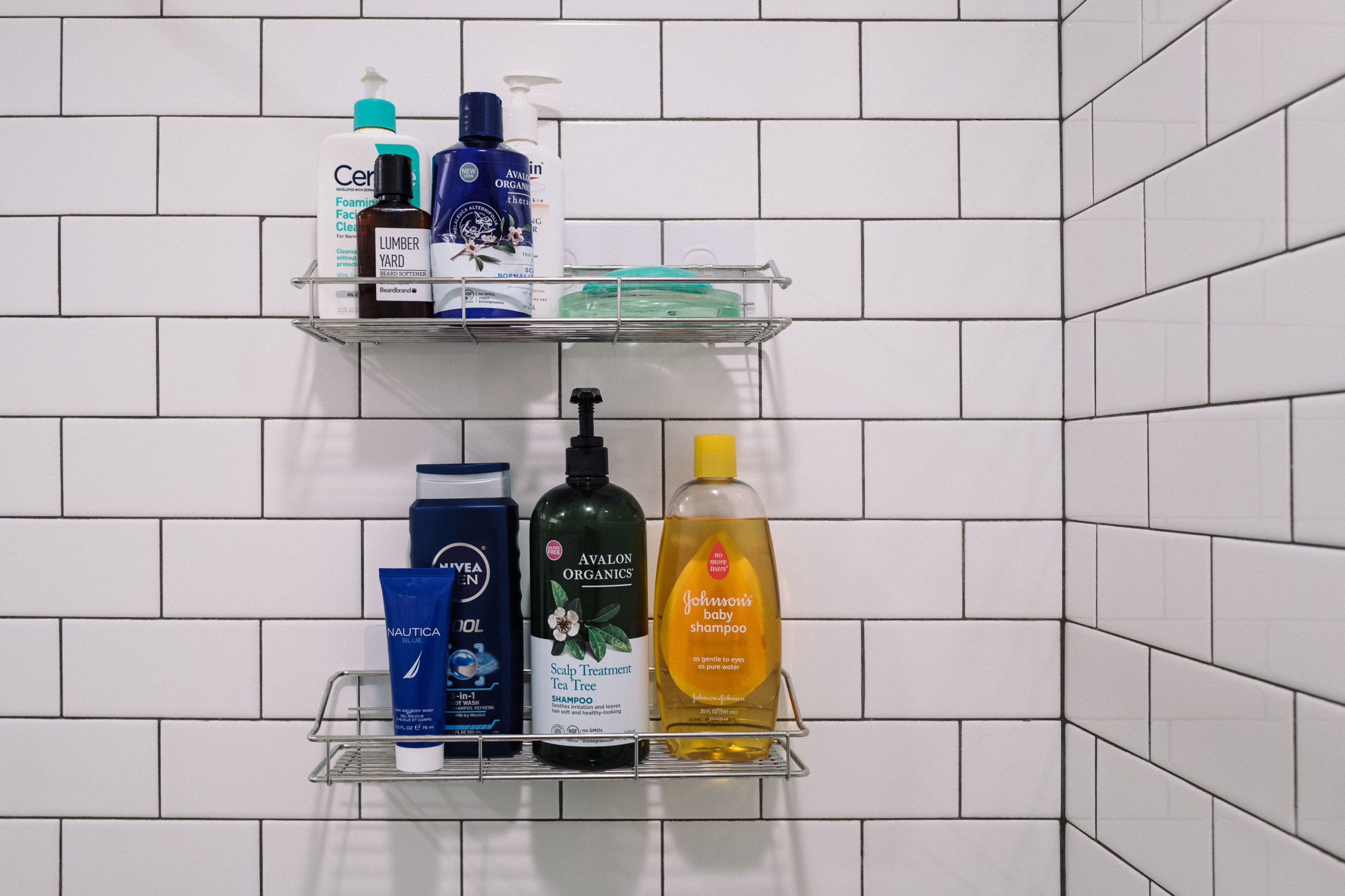 a shower organizer with shampoo and soap