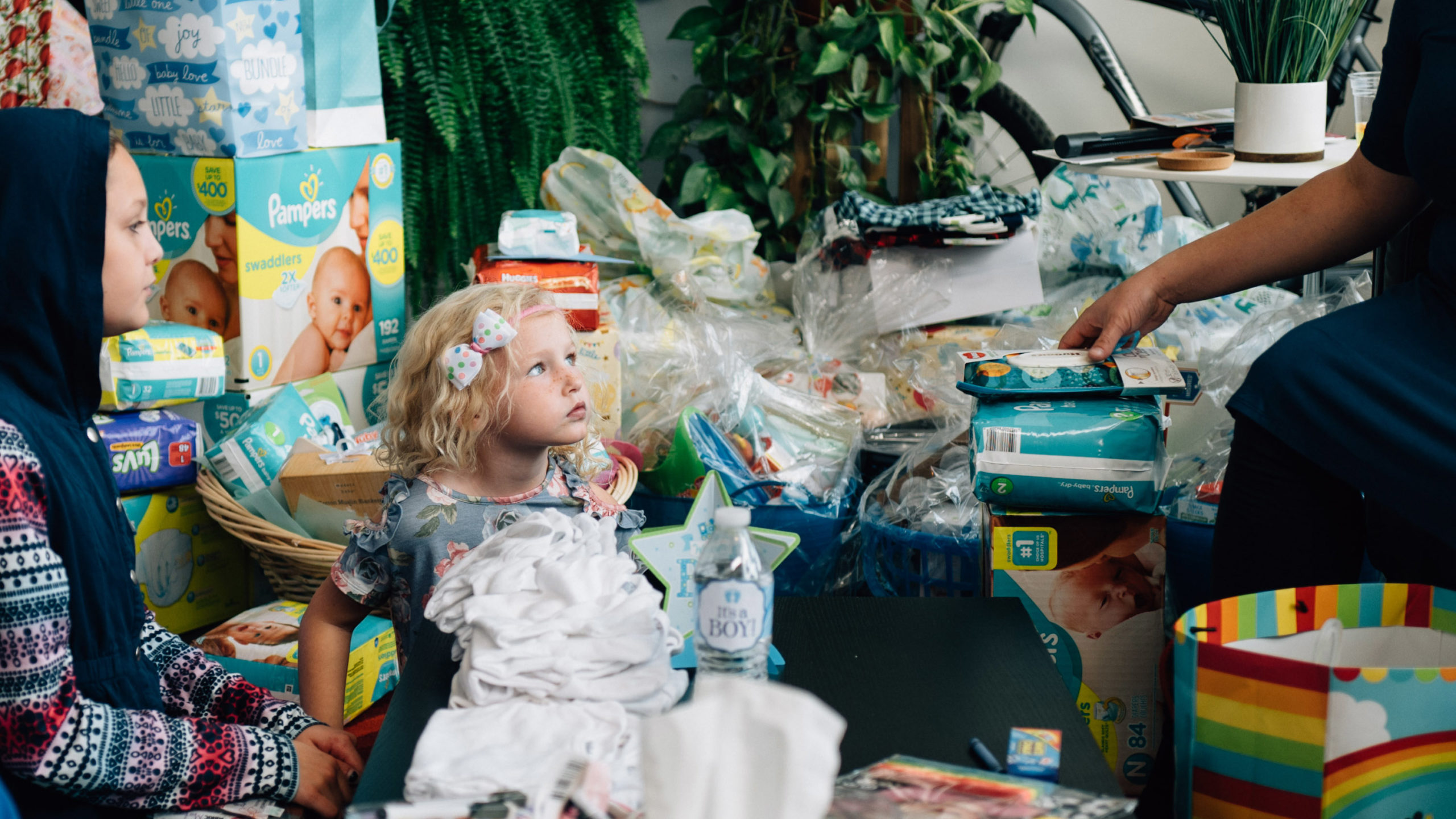A young girl surrounded by gifts