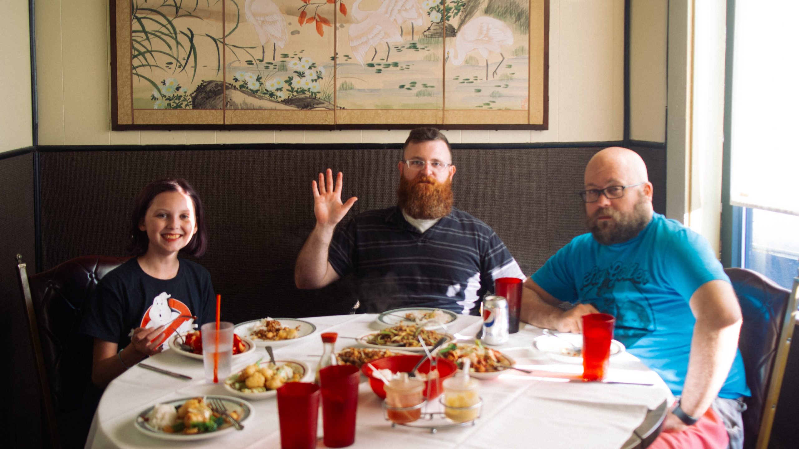three diners at a Chinese restaurant