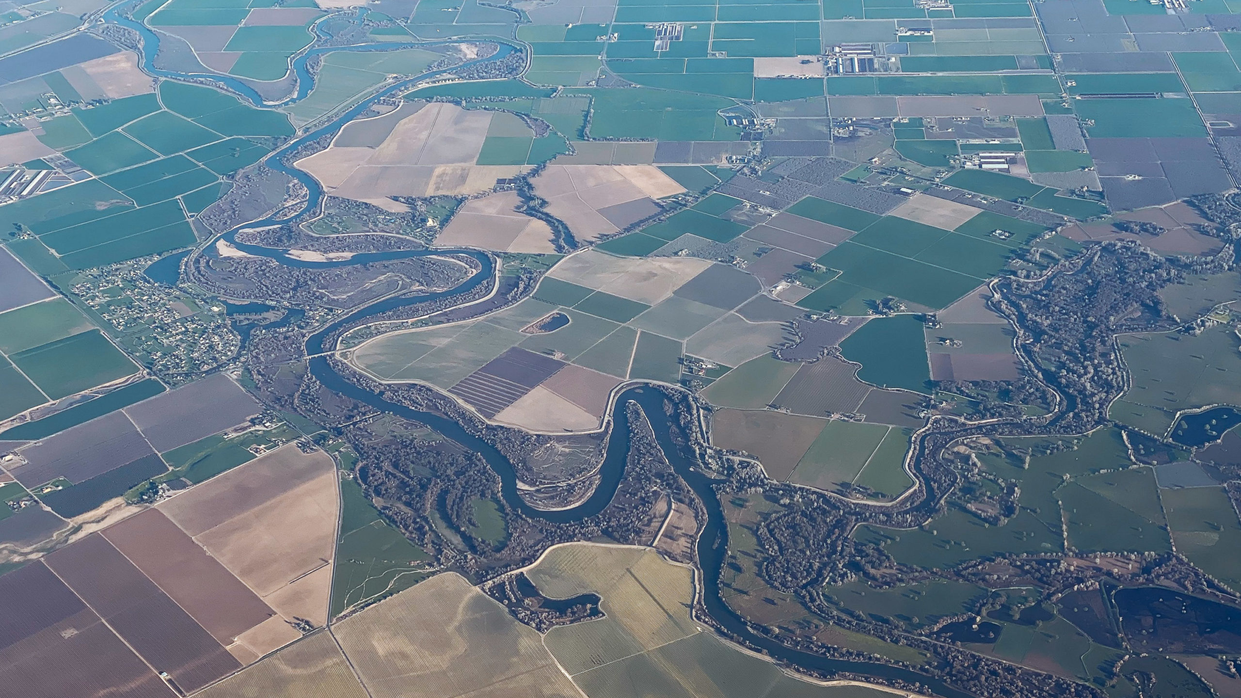 view from plane of fields and river