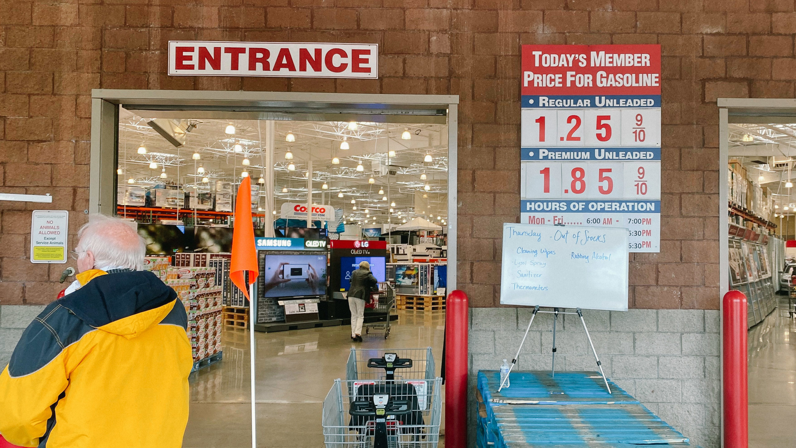 The entry to Costco with signs about social distancing