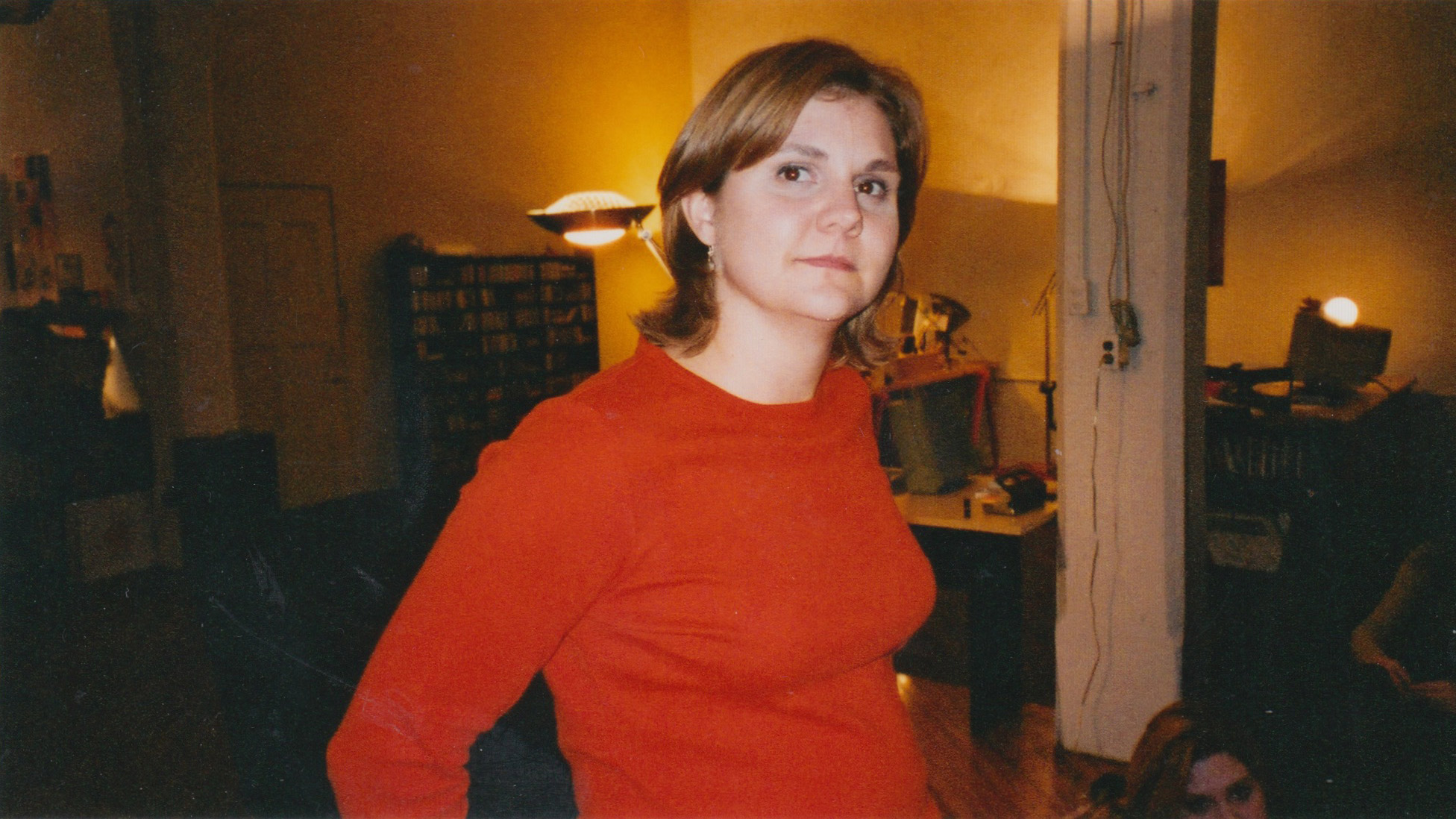 A woman in a red shirt