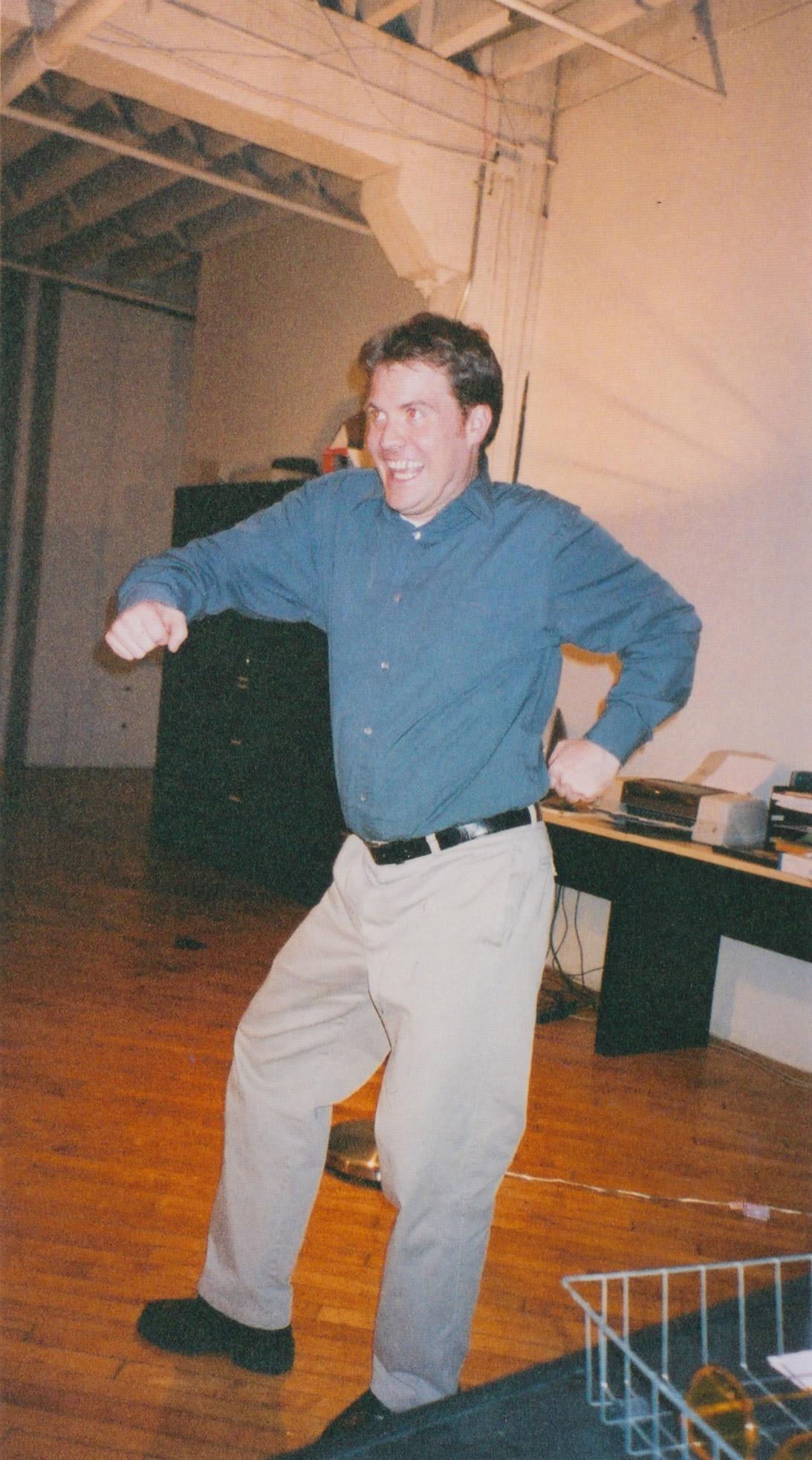A man in slacks dances