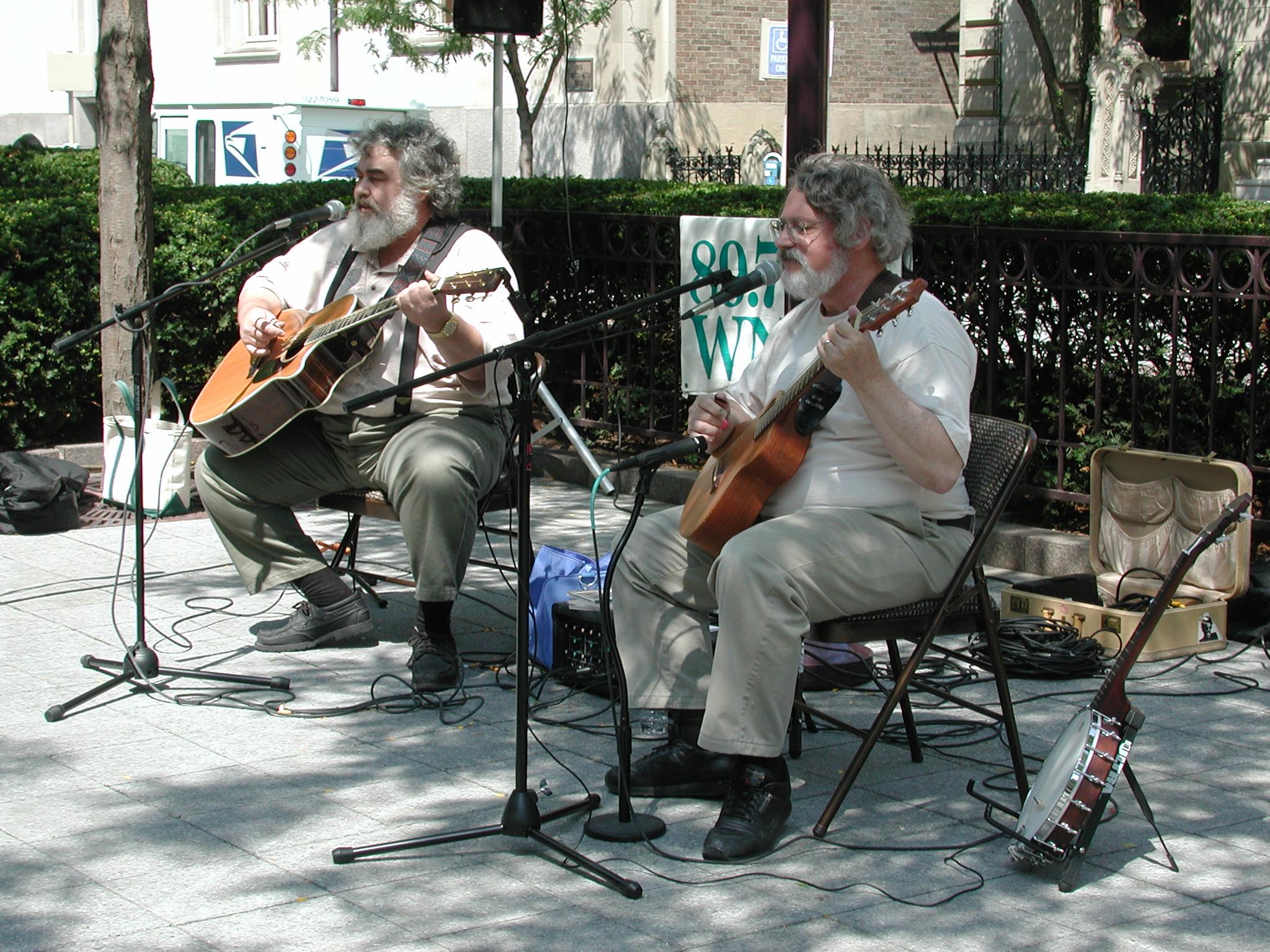 Two men play guitars