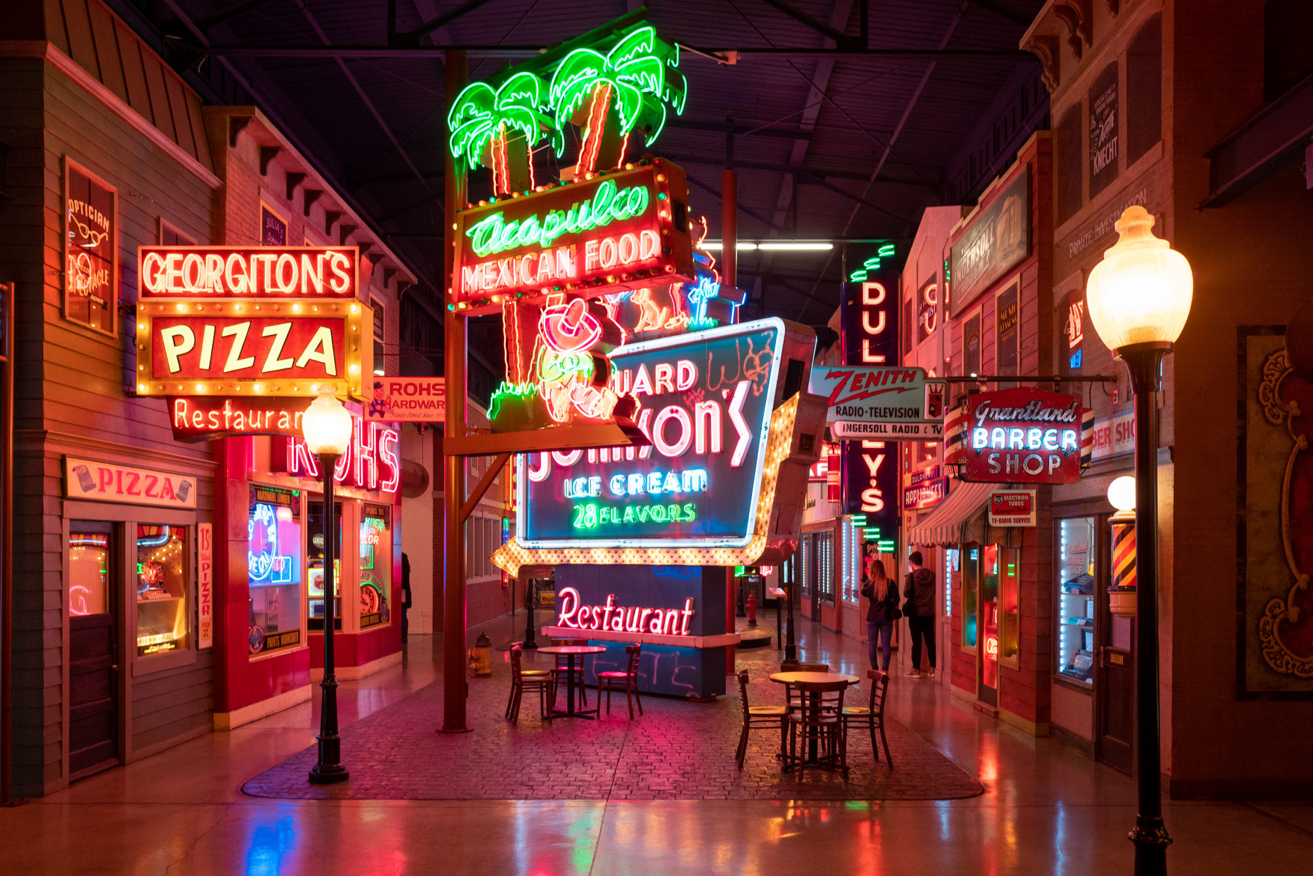 Neon signs fill a museum