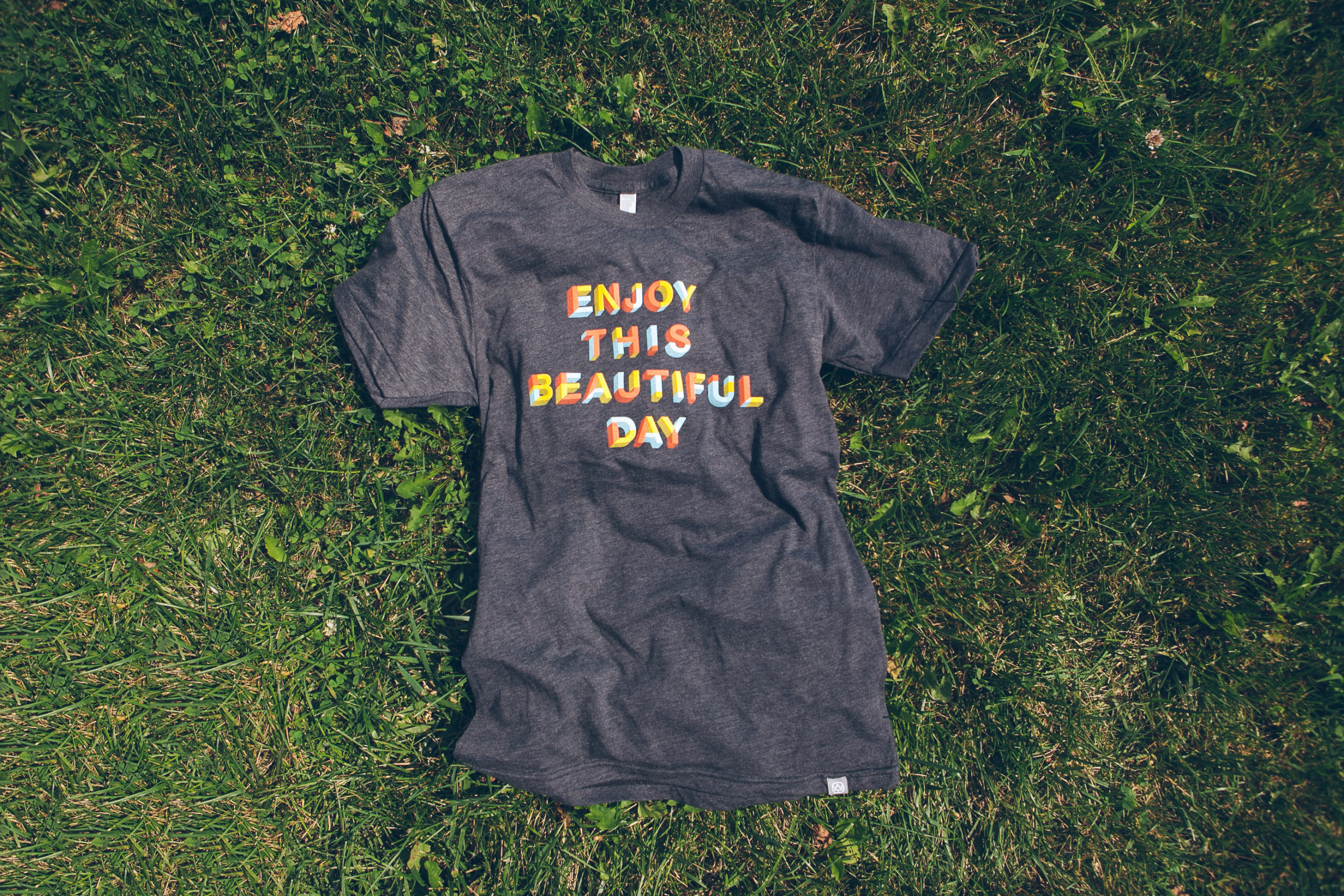 """T-shirt with a design that reads """"Enjoy This Beautiful Day"""""""