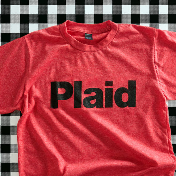 A shirt that has the word plaid on it