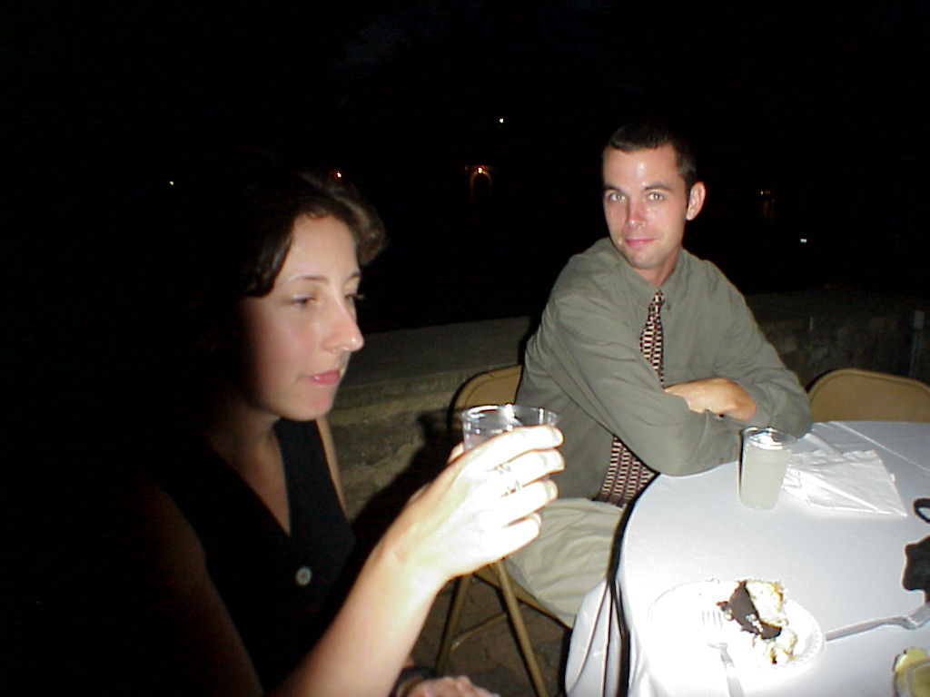 Two folks at a wedding table