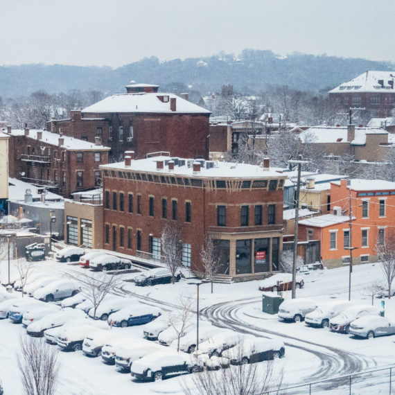 A snow covered neighborhood and parking lot